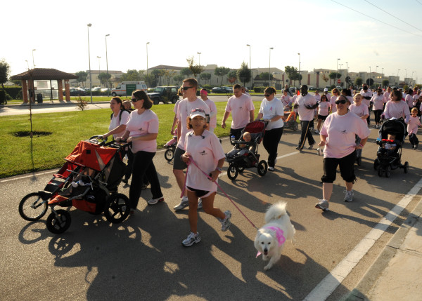 101023-N-3759T-036 NAPLES, Italy (Oct. 23, 2010) Service members and their families participate in a 1-Kilometer walk supporting National Breast Cancer Awareness Month at Naval Support Activity, Naples Support Site. The event drew 336 participants and provided an opportunity for the Naples military community to show their support and learn more about breast cancer awareness. (U.S. Navy photo by Mass Communication Specialist 2nd Class Jeff Troutman/Released)